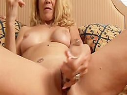 Lovely older lady lies back fucks her juicy pussy for you