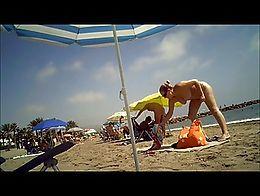 Topless milf on nudist beach