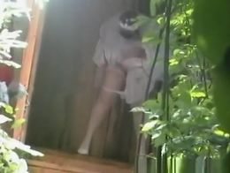 Bride caught lifting her wedding dress and pulling her silk panties down to take a pee in a woo...
