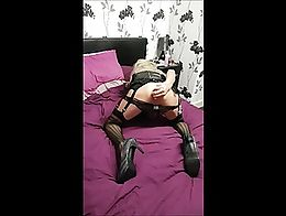 tranny uses a butt plug to gape her hole and make it wink ,whilst have her nipples puled by nip...