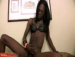 Naughty ebony shemale in bra is stroking her thick shecock
