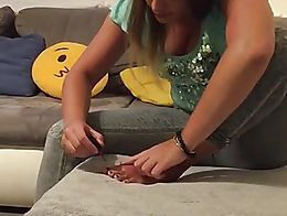 Lara is painting on her very fuckable nice Toes, enjoy!