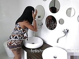 TGIRL Jessi is taking a bathroom break when she notices a black cock poking through the gloryho...
