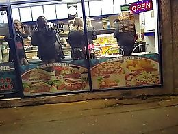 Lisa and the girls in the kebab shop at the end of a filming session.