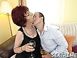 Lusty grandma Donatella is having a drink with her young friend, eyeing him with passion and ho...