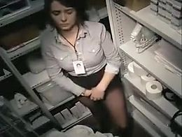 Girl at work stands half naked with her panties down, finger banging her needy pussy in as very...