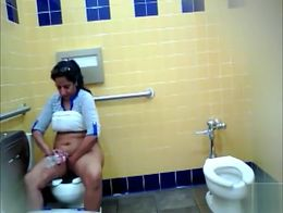She sits on the toilet and exposes her belly and vagina as she takes a piss. When she's done ...
