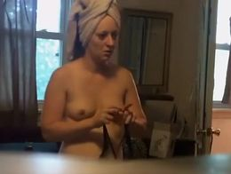 This nude chick walked in front of the hidden camera right after a shower and it enabled us to ...