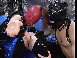 Two sluts and a guy in a kinky fist fuck session