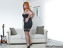 Redheaded milf Alex strips off her sexy black dress and finger fucks her mature pussy.