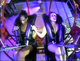 Two girls in skirts get on the ride and as it launches into the air their legs open and their p...