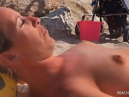 Fuckable MILF tanning on the beach