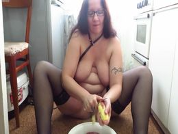 Mature milf with a big tits masturbates in the kitchen