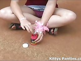 Kitty loves playing around in a tube top and miniskirt blowing bubbles and flashing her panties...