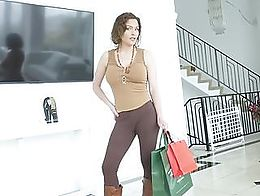 Sexy stepmom gets the hot attention of her stepson .