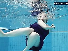 Teen girl swimming in the Russian pool and undressing her self