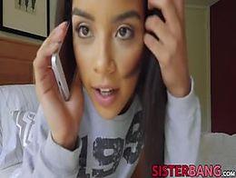 Teen Maya Bijou talking on the phone while getting drilled