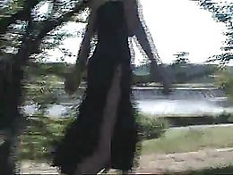 She is not wearing underwear. Her dress has a slit to the height of the waist.
