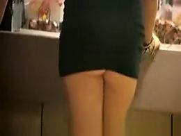 Drunk chick wearing a very short black dress that keeps pulling up exposing her sweet butt chee...