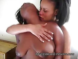 African hottie plays with her plump girlfriends coochie. This Afro beauty uses her fingers to m...