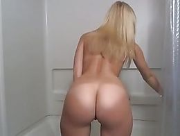 Pretty girl with perfect small tits, a hot ass and shaved pussy plays with dildo in shower for ...