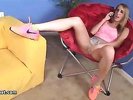 A hot blonde teen is vibrating her pussy before sucking a young guy's monster-sized prick.