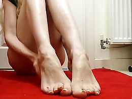 Hot blonde feet mistress teasing with her feet until you just want to submit and adore her fore...