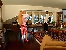 Mature piano teacher fucked by her black student