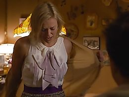 Charlize Theron shows her sexy attributes in the scene undressing. Her boobs are in a rubber br...
