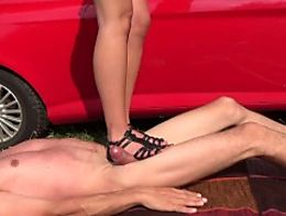 Cruel trampling stomping jumping on slave in sandals