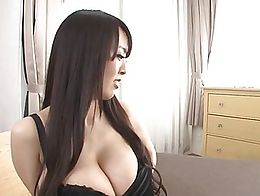 Hitomi Tanaka uses her huge fun bags on a lucky guy's dick