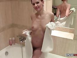Very beautiful babe taking a shower and gets filmed