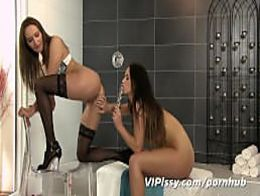 Simultaneous pissing girls after glass dildo play