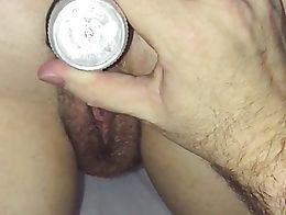 Dildo in her pussy and a butt plug in her ass.