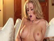 Gorgeous blonde babe Randy Moore shows off her round tits and opens her sexy legs to play with ...